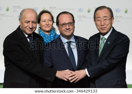 LE BOURGET near PARIS, FRANCE - NOVEMBER 30, 2015 : President of COP21 Laurent Fabius, French President Francois Hollande and Secretary General of the United Nationsat Ban Ki-moon at the Paris COP21. - stock photo