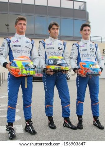 LE CASTELLET, FRANCE - SEPTEMBER 28: The Signatech-Nissan drivers posing during the World Series by Renault event at Circuit Paul Ricard on September 28, 2013 in Le Castellet, France. - stock photo