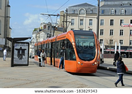 LE MANS, FRANCE - MARCH 25: views of the city of Le Mans in France and orange tram  March 25, 2014  - stock photo