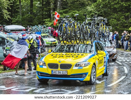 LE MARKSTEIN, FRANCE - JUL 13: The official car of the Team Saxo Thinkoff on the road to the mountain pass Le Markstein during Le Tour de France on July 13, 2014. - stock photo