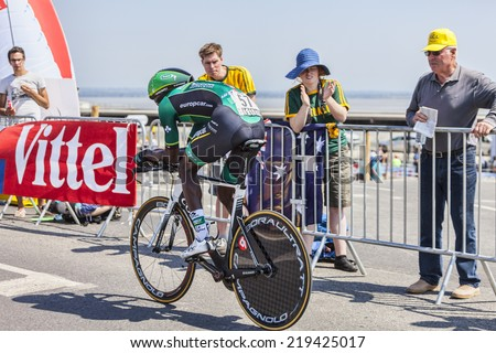 LE MONT SAINT MICHEL,FRANCE-JUL 10:The French cyclist Kevin Reza from Europcar Team cycling during the stage 11 of Le Tour de France 2013, a time trial between Avranches and Mont Saint Michel - stock photo
