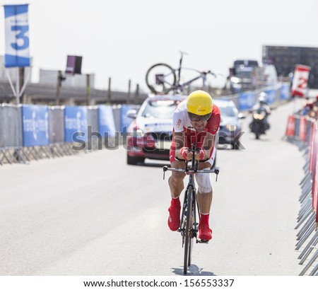 LE MONT SAINT MICHEL,FRANCE-JUL 10:The Spanish cyclist Egoitz Garcia from Cofidis Team cycling during the stage 11(time trial Avranches -Mont Saint Michel) of Le Tour de France on July 10, 2013 - stock photo