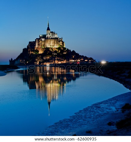 Le Mont-Saint-Michel in the twilight - stock photo