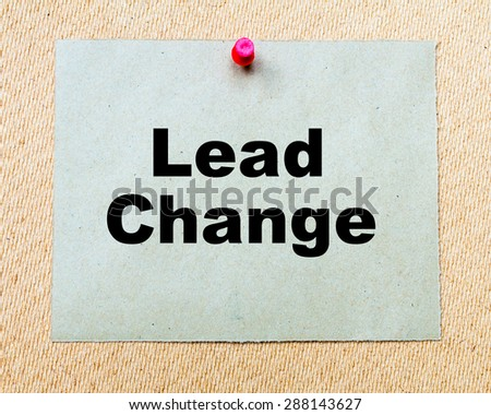 Lead Change written on paper note pinned with red thumbtack on wooden board. Business conceptual Image - stock photo