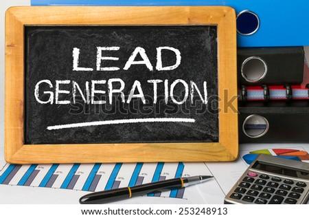 lead generation handwritten on blackboard - stock photo