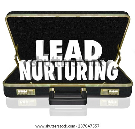 Lead Nurturing 3d words in a black leather briefcase to illustrate a sales or marketing campaign to educate customers, clients or prospects about your products or service - stock photo