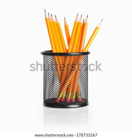 lead pencils in metal pot on a white background  - stock photo