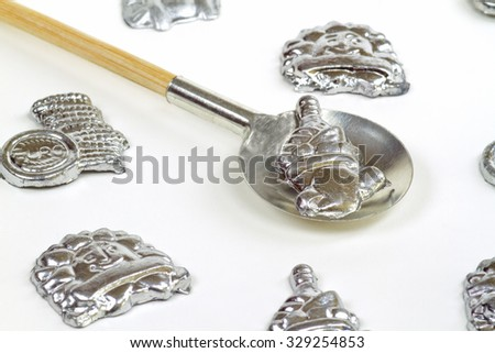 Lead pouring set on bright background - stock photo