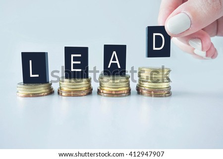 Lead text stacked on coins with cool image temperature  - stock photo