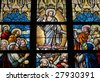 Leaded glass window in church of Alsemberg (close to Brussels in Belgium), made in 1895. Depiction of resurrected Jesus and the apostles (Pentecost). - stock photo