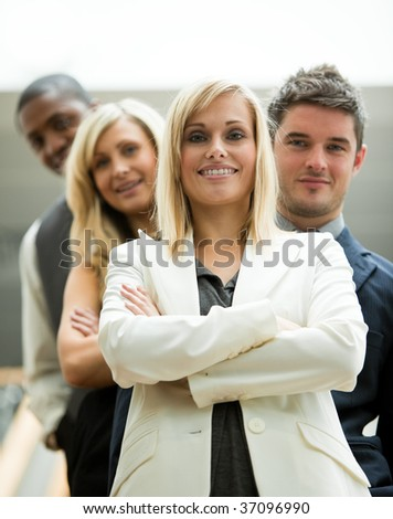 Leader and her team in the office - stock photo
