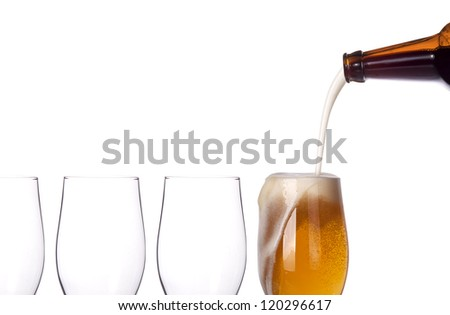 leader concept - empty and one full beer glass isolated on a white background - stock photo