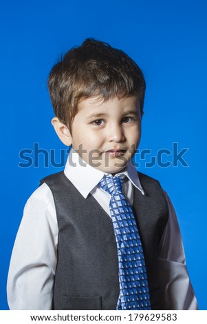 Leader, cute little boy portrait over blue chroma background - stock photo