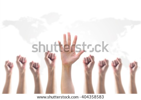 Leader's fist victory sign among blur hands crowd group: Many people blurred palms raising up upward isolated on white sky background map: World participation, leadership, volunteer concept  - stock photo