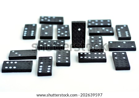 Leadership concept, domino standing out from the crowd, isolated on white background. copyspace - stock photo