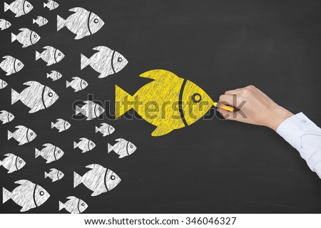 Leadership Concept Fish on Chalkboard - stock photo
