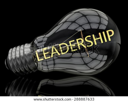 Leadership - lightbulb on black background with text in it. 3d render illustration. - stock photo