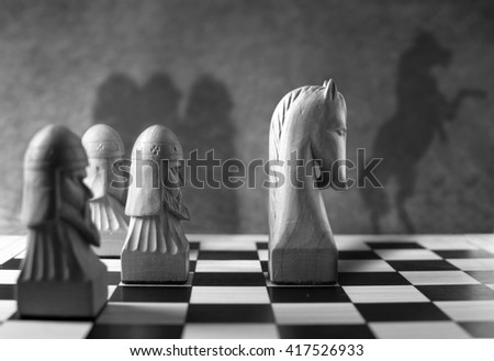 Leadership, success concept, chess piece with a rearing horse as shadow - stock photo