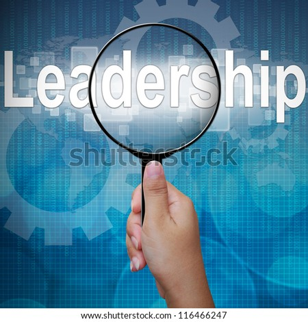 Leadership, word in Magnifying glass ,business background - stock photo