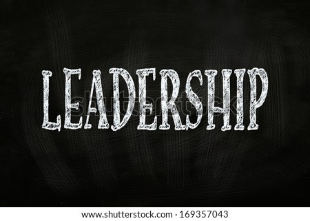 Leadership Writing, written with Chalk on Blackboard - stock photo