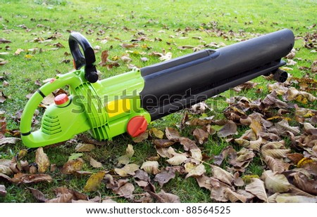 Leaf blower on the ground. - stock photo