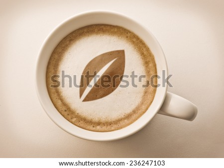 leaf drawing on latte art coffee cup for organic business - stock photo
