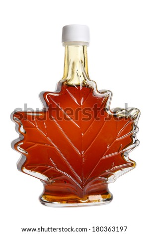 Leaf shaped bottle of maple syrup, cutout on white background - stock photo