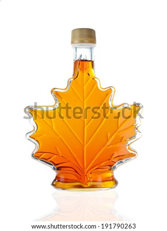 Leaf Shaped Canadian Glass Maple Syrup Bottle Isolated On A White Background - stock photo