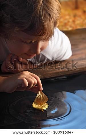 leaf ship in children hand - stock photo