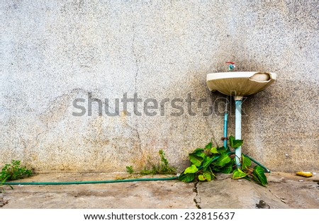 leak and ruin sink in dirty old bathroom . - stock photo