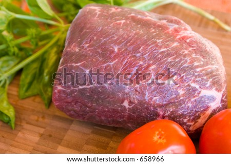 Lean piece of buffalo rump roast prepared to be grilled or roasted.  This lean meat is very healthy and acceptable to those watching their weight. - stock photo