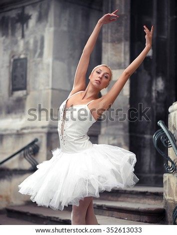 Leaning to the sky. Cropped shot of a young ballet dancer looking at the camera while dancing outdoors soft focus  - stock photo