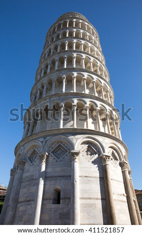 Leaning Tower of Pisa in Tuscany, Italy.  Photographed in soft side lighting and from a dramatic angle.  Concepts could include architecture, travel, European culture, others. - stock photo