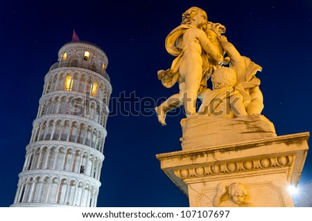Leaning Tower of Pisa with statue after sunset, Tuscany, Italy - stock photo