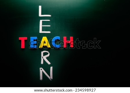 Learn and teach concept, words on blackboard - stock photo