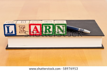Learn Blocks on Text Book - stock photo