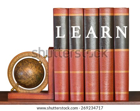 Learn concept with encyclopedia and globe on white background - stock photo