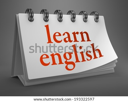Learn English - Red Words on White Desktop Calendar Isolated on Gray Background. - stock photo