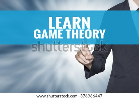 Learn Game Theory word on virtual screen touch by business woman cyan sky tab - stock photo
