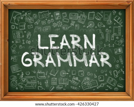 Learn Grammar - Handwritten Inscription by Chalk on Green Chalkboard with Doodle Icons Around. Modern Style with Doodle Design Icons. Learn Grammar on Background of  Green Chalkboard with Wood Border. - stock photo