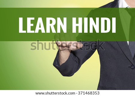 Learn Hindi word Business man touch on vintage yellow green tab virtual screen - stock photo