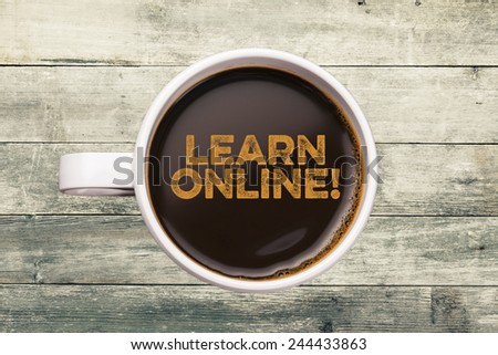 learn online! coffee mug with wood background - stock photo