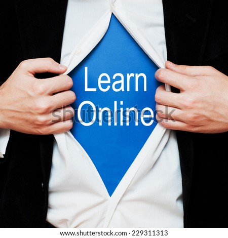 Learn Online Concept. Man showing a superhero suit underneath his shirt with a message text written on it. - stock photo