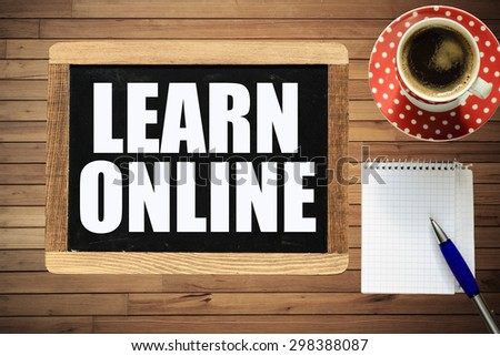 Learn online on blackboard. Learn online On blackboard with cup of coffee, notebook and pen on wooden background - stock photo