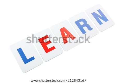 Learn word formed by educational paper cards isolated on white - stock photo