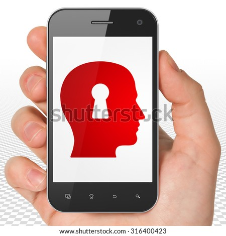 Learning concept: Hand Holding Smartphone with red Head With Keyhole icon on display - stock photo