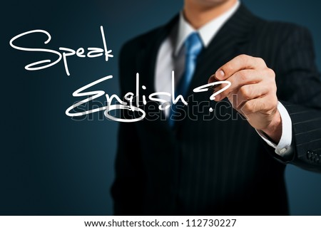 Learning English. Man writes on the screen Speak - stock photo