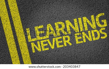 Learning Never Ends written on the road - stock photo