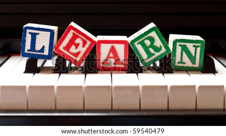 Learning The Piano - stock photo