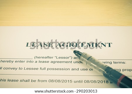 Lease Agreement Contract Document and Pen Horizontal View on Wood Table in Vintage Style. Legal document for business event - stock photo